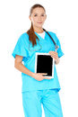 Female doctor with a tablet pc attractive serious young or nurse in green scrubs or notebook displayed in her hands screen visible Royalty Free Stock Photography