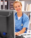 Female doctor working on her computer Royalty Free Stock Image