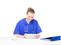 A female doctor working in the office young professional and cheerful isolated on white Royalty Free Stock Image