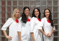 Female doctors four in wearing white uniforms Royalty Free Stock Photos
