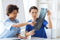 Female doctors with x-ray image at hospital Royalty Free Stock Photo