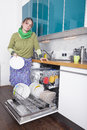 Female doing housework Stock Images