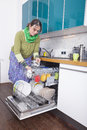 Female doing housework Royalty Free Stock Photography