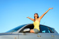 Female driver bliss on car joyful woman sitting window new raising arms up to the sky summer trip blissful and fun happy girl Royalty Free Stock Photos