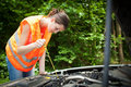 Female driver over the engine of her broken down c Royalty Free Stock Images