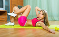 Female with dumbbells at home happy young woman training Stock Image