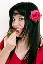 Female eating fresh strawberries in chocolate Stock Photo