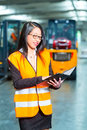 Female employee or supervisor at warehouse logistics worker using tablet computer of freight forwarding company Royalty Free Stock Images