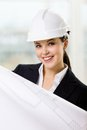 Female engineer in hard hat hands sketch Royalty Free Stock Photography