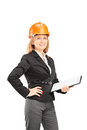 Female engineer with a helmet holding a clipboard and posing isolated on white background Royalty Free Stock Images