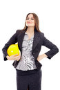 Female engineer holding helmet young attractive a with hand on waist isolated over white background Royalty Free Stock Image