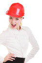 Female engineer woman architect in red safety helmet isolated portrait of attractive on white building studio shot Royalty Free Stock Images