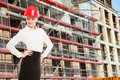 Female engineer woman in red safety helmet on construction site attractive working architect building Stock Photography