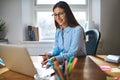 Female entrepreneur working on laptop Royalty Free Stock Photo
