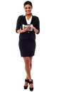 Female executive using touch pad full length shot studio of a corporate woman operating Stock Photo