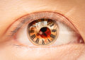 Female eye roman numerals bio clock Stock Photo