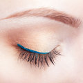 Female eye zone and brows with day makeup closeup shot of woman closed blue arrow Stock Photo