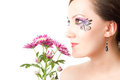 Female face with pink chrysanthemum. Royalty Free Stock Images