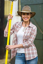 Female farmer pitch fork happy holding a inside stable Royalty Free Stock Photography