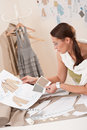 Female fashion designer working with sketches Royalty Free Stock Photo