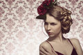 Female with fashion romantic style cute blonde girl posing in shoot elegant floral hair red sexy dress and heart shaped make up Stock Photos