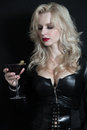 Female fatale a blonde with a glass of red wine Stock Images
