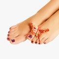 Female feet with beautiful pedicure after spa procedure Royalty Free Stock Image