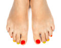 Female feet with a pedicure color on white background Stock Photo