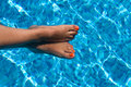 Female feet in pool Royalty Free Stock Photography