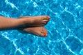 Female feet in pool