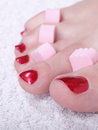 Female feet red polished nails close up of with carefree chiropody Royalty Free Stock Images