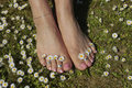 Female feet relaxing on grass lawn Stock Images