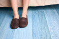 Female feet and slippers Royalty Free Stock Photo