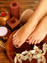 Female feet at spa salon on pedicure procedure closeup photo of a legs care concept Royalty Free Stock Images