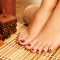 Female feet at spa salon on pedicure procedure closeup photo of a soft focus image Stock Photography