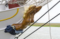 Female figure with naked body on the bow of a sailboat Royalty Free Stock Photo