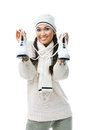 Female figure skater holds skates Royalty Free Stock Photos