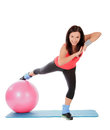 Female with fitness ball in sport center attractive young over white Stock Images