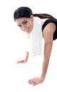 Female fitness trainer doing push ups Royalty Free Stock Image