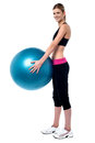 Female fitness trainer holding swiss ball full length shot of charming pilates Royalty Free Stock Photos