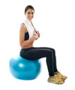 Female fitness trainer sitting on ball Stock Image