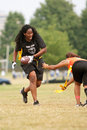 Female Flag Football Player Avoids Defender Stock Photo