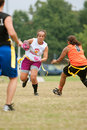 Female Flag Football Player Dodges Defenders Royalty Free Stock Photography