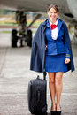 Female flight attendant Stock Photo