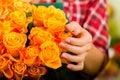 Female florist in flower shop Stock Image