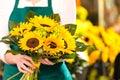 Female Florist Holding Bouquet...