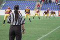 Female football referee observing the match Royalty Free Stock Image