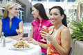 Female Friends Enjoying At a Restaurant Royalty Free Stock Images