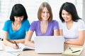 Female friends three studying together in a classroom Royalty Free Stock Photography
