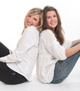 Female friends two young leaning on each other Stock Photos